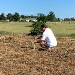 Progress Gallery Dave putting stake in ground out new home site
