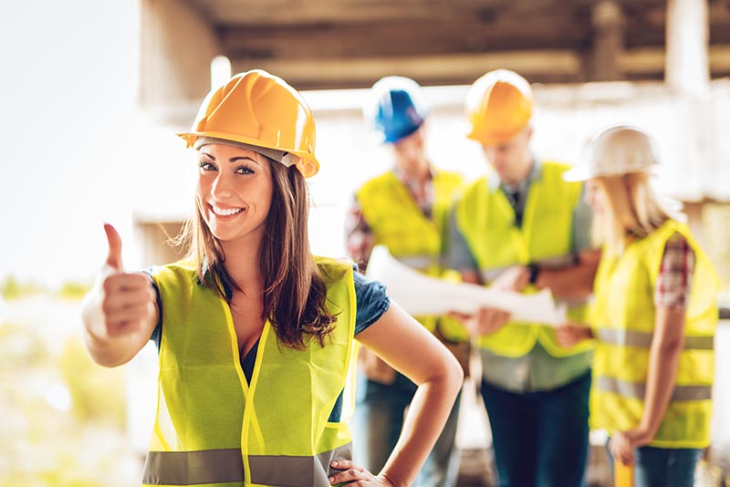 Men and Women at a construction site