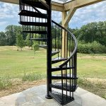 Outdoor spiral staircase connecting to the second floor deck